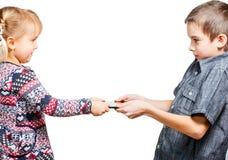 Combat d'enfants pour la tablette Photo stock