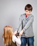 Combat d'enfants pour la tablette Image stock