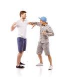 Combat de jeunes hommes Photos stock