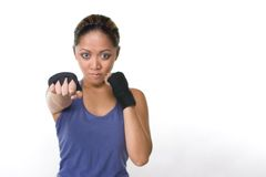Combat fighter. A great punch from a female fighter stock images