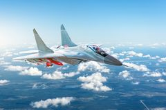Combat fighter with weapons flying over the clouds. royalty free stock photo