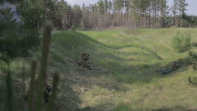 Combat firefight in the woods. World war II. The reconstruction of the battle stock footage