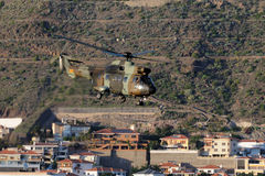 Combat helicopter, flying over the city Stock Photography