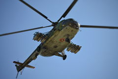 Combat helicopter flying  underneath view Royalty Free Stock Images
