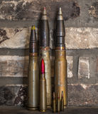 Combat large bullets. Fighting big bullets are on the rocky background Royalty Free Stock Images