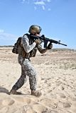 Combat movement. US soldier going through the desert during the military operation Stock Photo