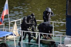 Combat swimmers work out the capture of a terrorist at the stern of a river vessel. stock image