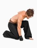 Combatiente de los artes marciales del arrodillamiento Foto de archivo libre de regalías
