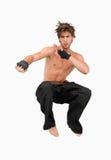 Combatiente de salto de los artes marciales Foto de archivo libre de regalías