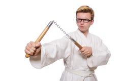 Combatiente divertido del karate con los nunchucks Imágenes de archivo libres de regalías