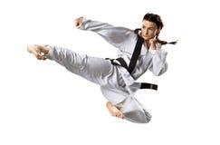 Combatiente femenino profesional del karate aislado encendido Foto de archivo