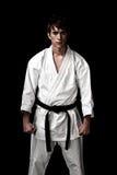 Combatiente masculino del karate del alto contraste en negro fotografía de archivo libre de regalías