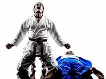 Combatientes de Judokas que luchan siluetas de los hombres Imagen de archivo libre de regalías