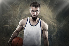 Combative athletes with ball. Athletic young man with football  and sport dress Stock Image