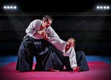 Combattenti di arti marziali alla palestra immagine stock libera da diritti