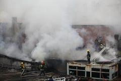 Combattenti di fuoco in servizio Fotografia Stock