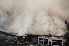 Combattenti di fuoco in servizio Fotografie Stock