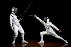 Combattere di due schermitori Fotografie Stock