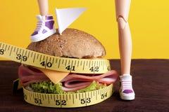 Combattez pour perdre le poids avec des régimes photographie stock