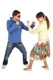 Combattimento amichevole fra un tirante e una ragazza Immagine Stock Libera da Diritti