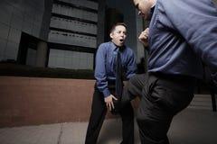 combattimento degli uomini d'affari Fotografia Stock