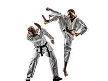 Combattimento dei combattenti dello studente dell'adolescente degli uomini di karatè Fotografia Stock Libera da Diritti
