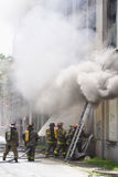 Combattimento del fuoco Immagini Stock