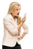 Combattimento infelice della donna facendo uso del telefono cellulare isolato sulla parte posteriore di bianco Fotografia Stock