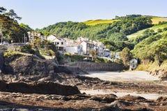 Combe Martin Devon UK. Combe Martin, Devon, England, UK - The rocky beach and the village royalty free stock photography