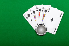 Combinação de vencimento em um resplendor real do póquer Fotos de Stock Royalty Free