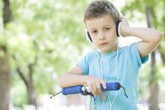 Combinação, música e 'trotinette' ideais Imagem de Stock Royalty Free