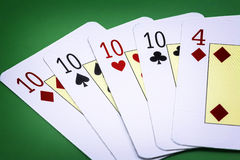 Combination of cards called poker on green background Stock Image