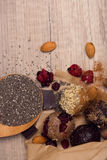 Combination of chia seeds, raw, homemade sweet balls on wooden b Stock Image