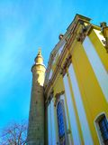 Combination of cultures, Rome Catholic Cathedral and Turkish minaret, Kamenets-Podolsky, Ukraine. View of a prayer tower and a Roman Catholic cathedral what royalty free stock photos