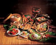 LOCAL CUISINES. Variety of local cuisines from Malaysia. Satay, Nasi lemak, murtabak, fried prawn, claypot rice and etc royalty free stock image