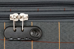 Combination lock. On suitcase and closed zipper Stock Image