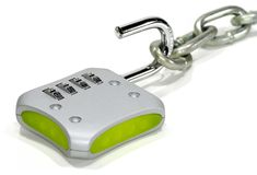 Combination Lock. Photo of a Combination Lock and a Chain - Security Royalty Free Stock Image