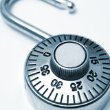 Combination Lock. A combination lock that you would use to protect your valuables in square format and in blue tint Royalty Free Stock Image