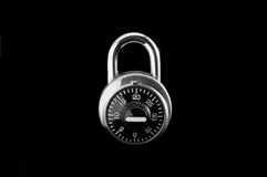 Combination Lock. Against black background stock images