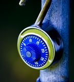 Combination Lock. On outside gate with blue overtones Stock Image
