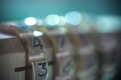 Combination lock. Abstract blurry background royalty free stock image