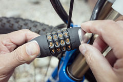 Combination lock bike accessory locking a bicycle Royalty Free Stock Images