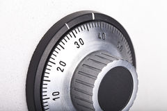 Combination lock close-up. Combination lock on the safe closeup gray Royalty Free Stock Photography
