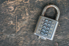 Combination lock. On old wooden table Royalty Free Stock Photos