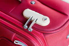 Combination lock. On red suitcase travel bag Royalty Free Stock Image