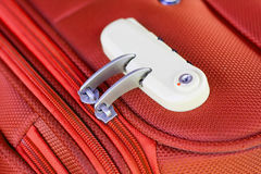 Combination lock. On red suitcase travel bag Royalty Free Stock Photo