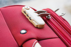 Combination lock. On red suitcase travel bag Stock Image