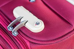 Combination lock on suitcase travel bag Royalty Free Stock Photography