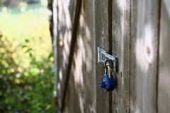 Combination lock on wooden door Stock Image