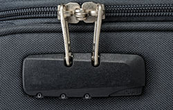 Combination lock for zipper on a suitcase Stock Image